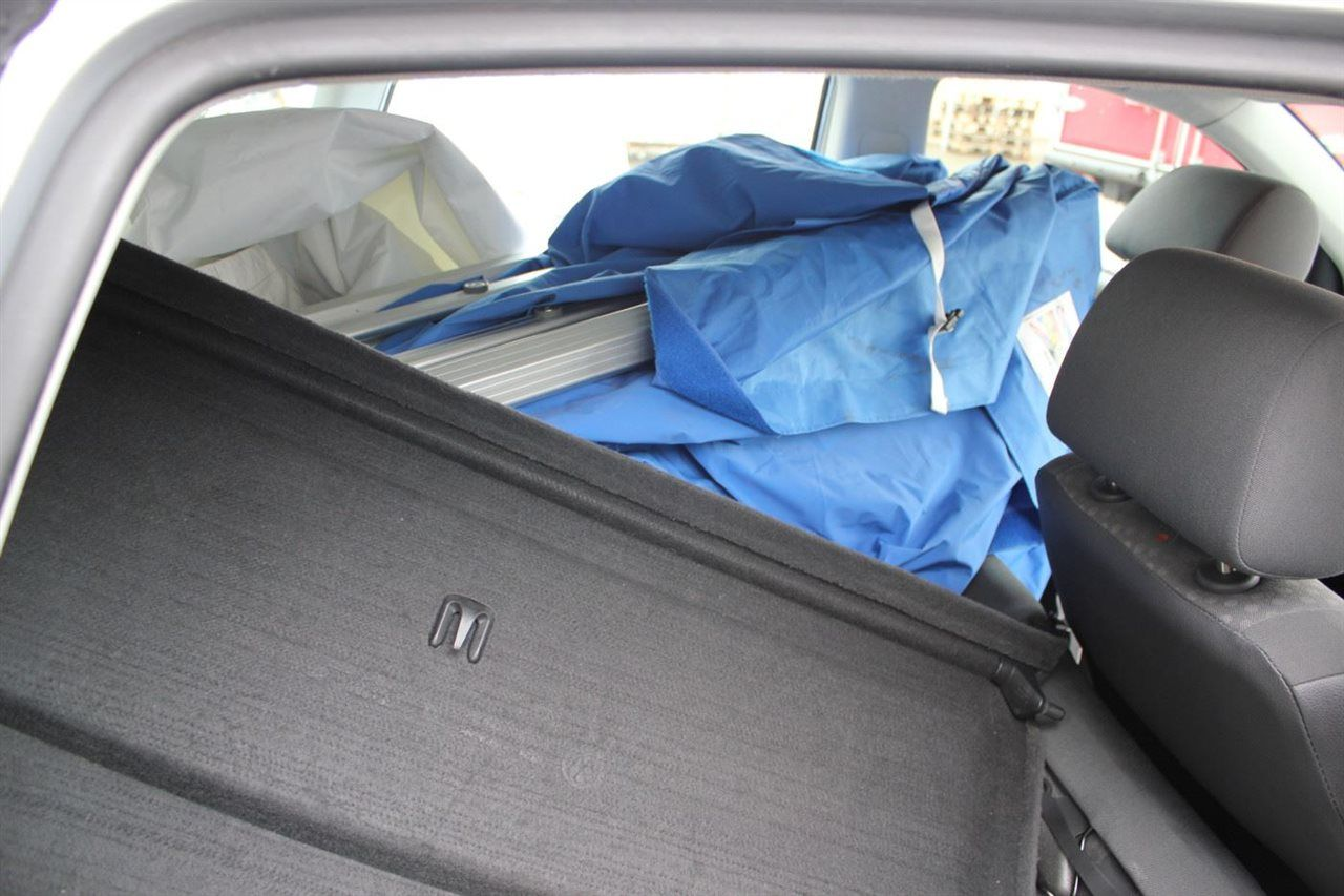 Compact gazebo in small car